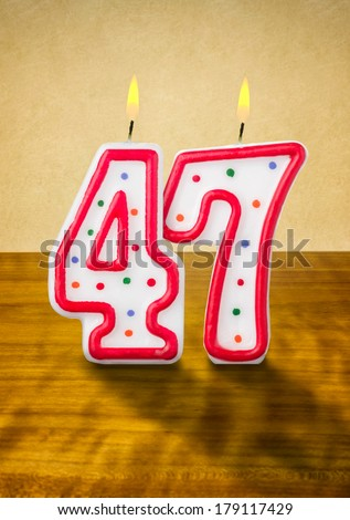 stock-photo-burning-birthday-candles-number-179117429.jpg