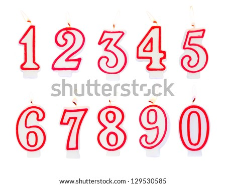 Burning birthday candles numbers isolated on white background - stock photo