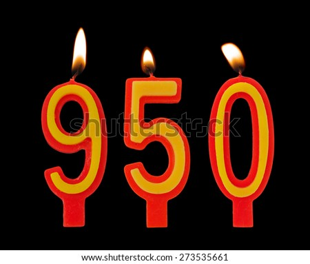 Burning birthday candles on black, number 950 - stock photo