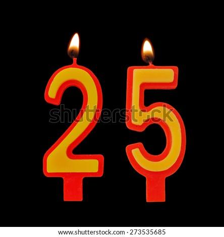 Burning birthday candles on black, number 25 - stock photo