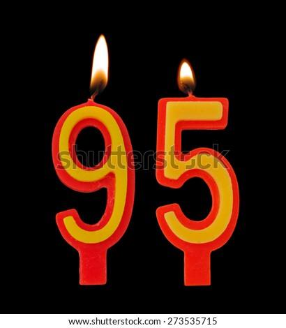 Burning birthday candles on black, number 95 - stock photo