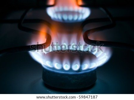 Burning blue gas on a cooker - stock photo