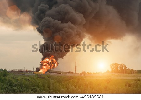 Burning building with flames and black smoke - stock photo