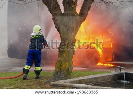 Burning bus hit firefighters - stock photo