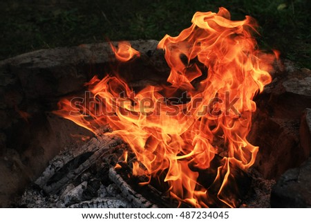 Burning camp fire with hot flames