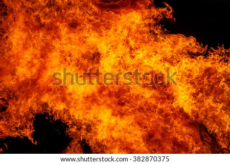 Burning campfire at night, combs flame as texture and background, strong branches burning trees of a forest fire - stock photo