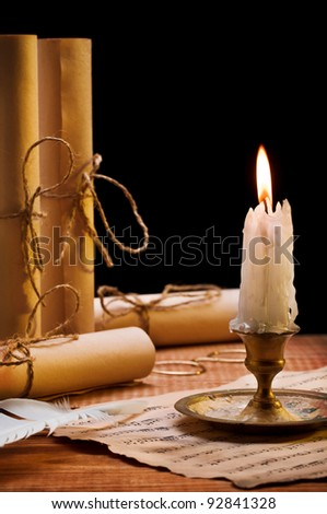 burning candle and antique items