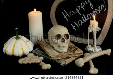 burning candle and  skull. halloween image - stock photo