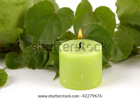 burning candle Green candle and ivy