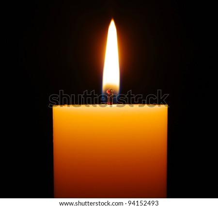 burning candle isolated on black - stock photo