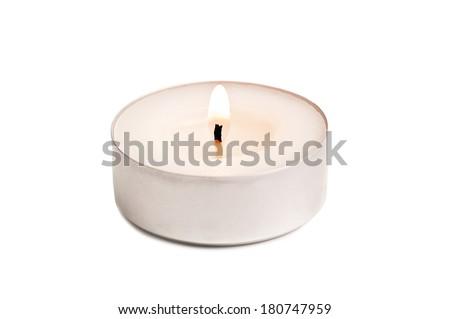 burning candle on white background - stock photo