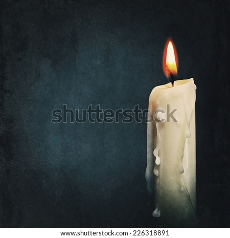 Burning candle over black. Is not isolated, just shot on black