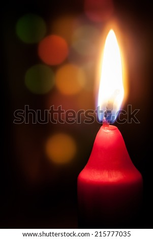burning candle with a colored background - stock photo