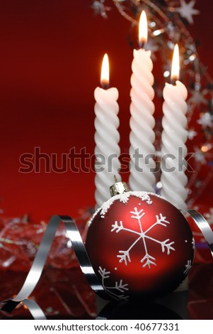 Burning candles and ornament for christmas celebration. - stock photo