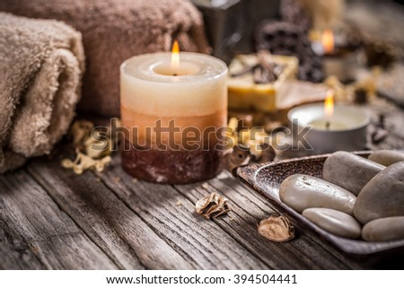 Burning candles for aromatherapy session - stock photo