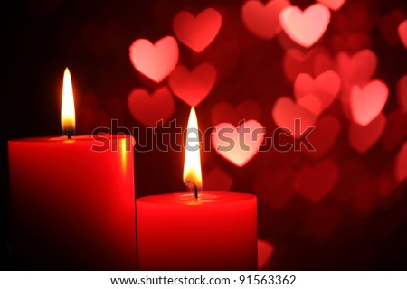 Burning candles for Valentine's Day, weddings,events involving love. - stock photo