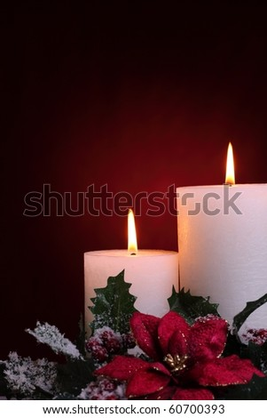 Burning candles in a Christmas setting.
