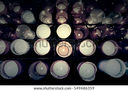 Burning candles in a church, detail of candles for wishes, belief and faith