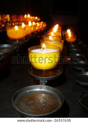 Burning candles in a church for worship. - stock photo