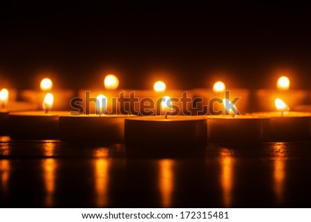 burning candles in a row