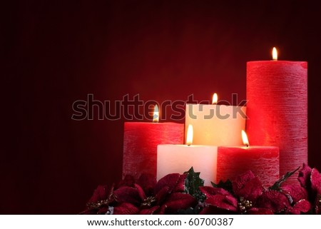 Burning candles in Christmas setting - stock photo