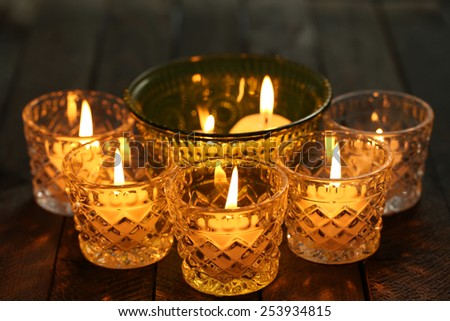 Burning candles in glass candlesticks close-up - stock photo