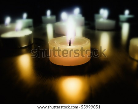 Burning candles in the dark - stock photo