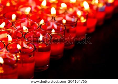 Burning candles light to worship Buddha - stock photo