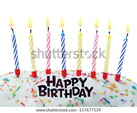 burning candles on a birthday cake on a white background