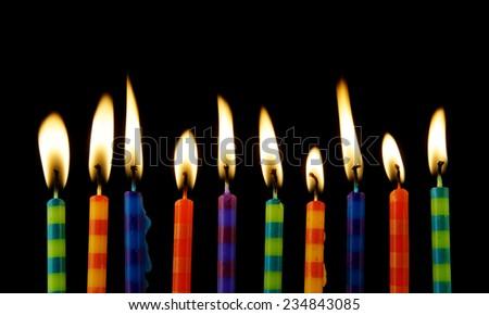 Burning candles on black background  - stock photo