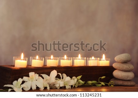 Burning candles,orchid flower and zen stone,zen concept. - stock photo