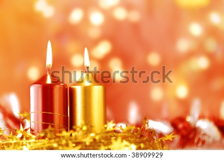 Burning candles with christmas setting