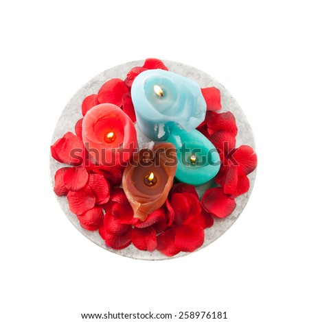 Burning candles with rose petals. Square image on white. - stock photo