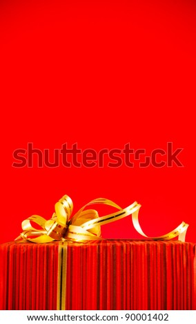 Burning candles with two heart shaped toys against red background - stock photo