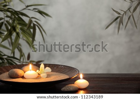 Burning candles with zen stone in bowl,zen concept. - stock photo
