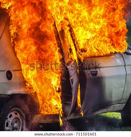 Burning car after accident on road. Flames and fire