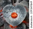 Burning charcoal formed heart shape - stock photo