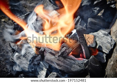 Burning Charcoal in BBQ. Close-up. - stock photo
