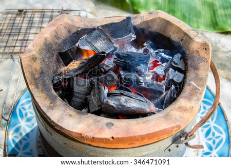 burning charcoal in old stove, thailand tradition