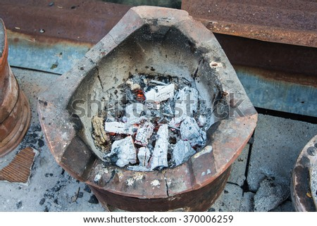 burning charcoal in the old stove