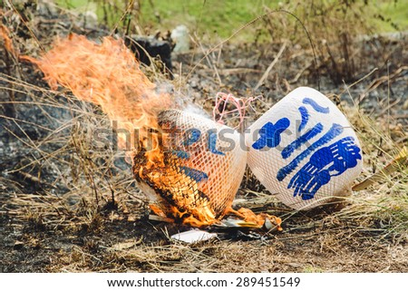 Burning Chinese lantern in traditional Chinese funeral ceremony - stock photo