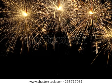 burning christmas sparklers isolated on black background  - stock photo