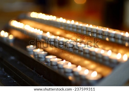 Burning church candles in a row - stock photo
