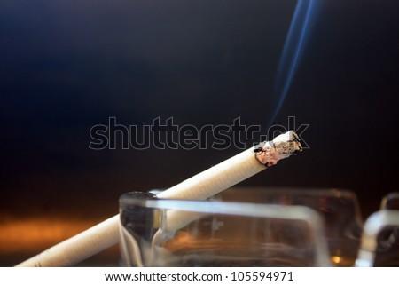 burning cigarette with smoke - stock photo