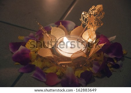 Burning Clay diya with flowers - stock photo