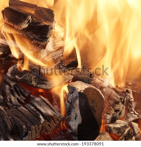 Burning Coals close-up. Square Background with space for text or image. - stock photo