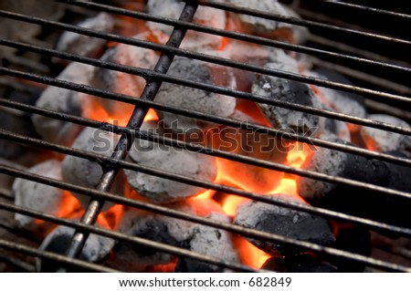 burning coals in barbecue grill - stock photo