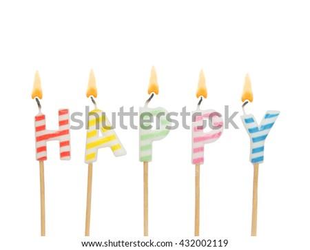 Burning colorful candles isolated on white background, word happy - stock photo