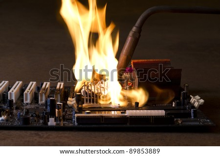 burning computer main board in rusty background. Copy space