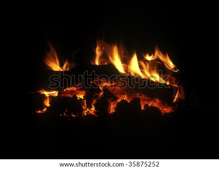 Burning down fire wood, fireplace, shine decayed coal in darkness